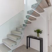 Floating glass panel staircase